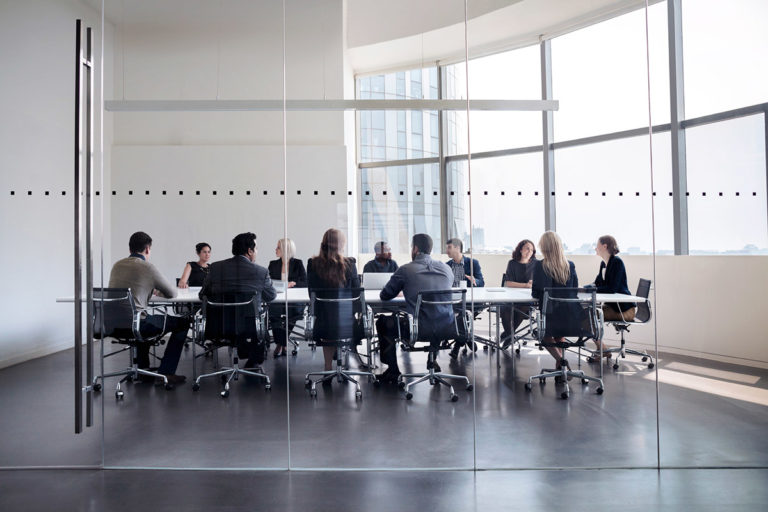 Leaders at business meeting in conference room