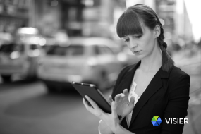 woman-on-tablet-in-city-feature