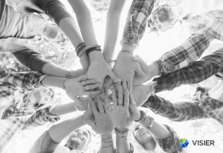 Hands together in a circle for employee engagement