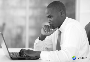 An HR executive looking at data and analytics to keep Finance and HR in sync for accurate workforce planning