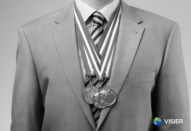 """Image of an HR executive with medals in the Visier article """"Should HR Let Employees Watch the Summer Olympics at Work?"""""""