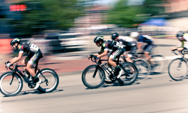 A group of bikers speeding through a race is a metaphor for measuring quality of hire with talent acquisition analytics