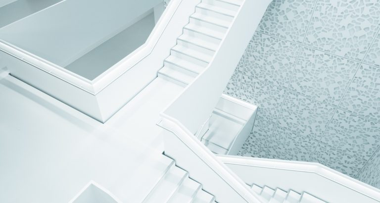 Set of white stairs going up and down