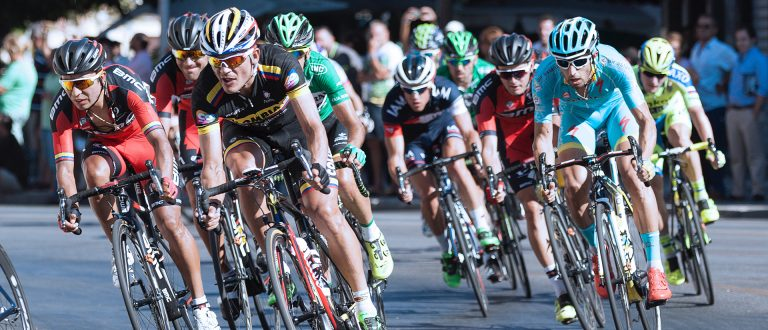 A group of cyclists racing to the finish