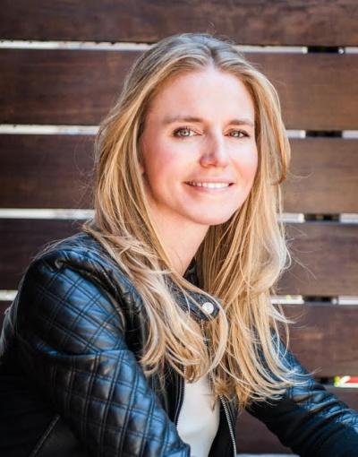 Tech entrepreneur Kristi Zuhlke smiles for the camera and discusses her data democratization platform, KnowledgeHound