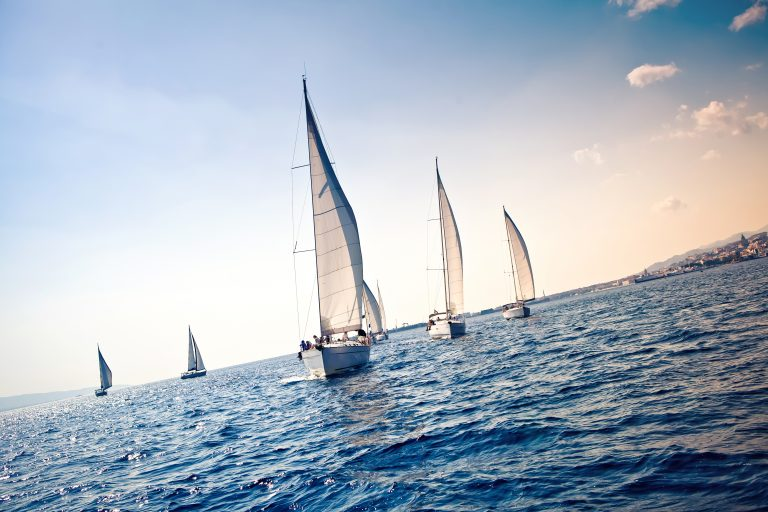 HR executives racing sailboats as a metaphor for their race to do mid-level HR analytics projects