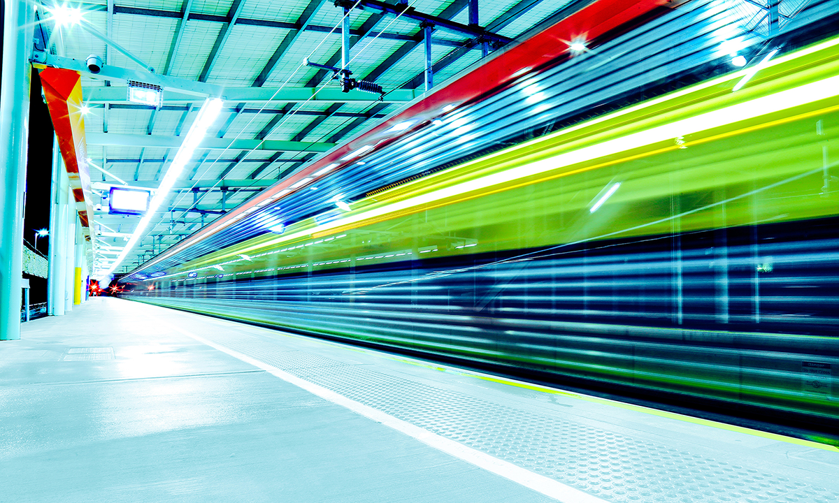 A fast moving train is a blur of multi-colored light and acts as a metaphor for telling a good data journalism story in HR