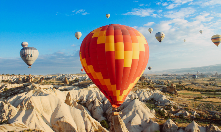 A bold orange hot air balloon serves as a metaphor for HR leaders to be bold with analytics this year