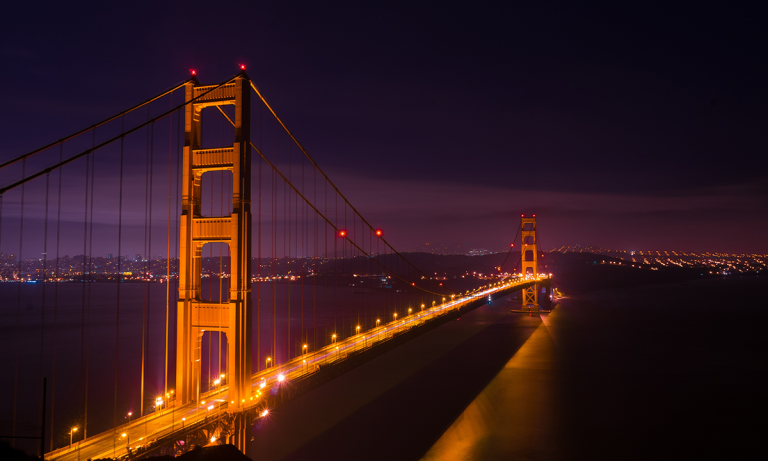 The Golden Gate Bridge in San Francisco is illuminated at night. San Francisco is where Visier Outsmart 2018 will take place May 23-24