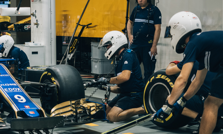 A pit crew representing why employee retention is so important and why it's time to end employee retention guesswork