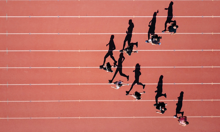 Runner's in a race on a track as a metaphor for the workforce with the most political skill thrives the most in business