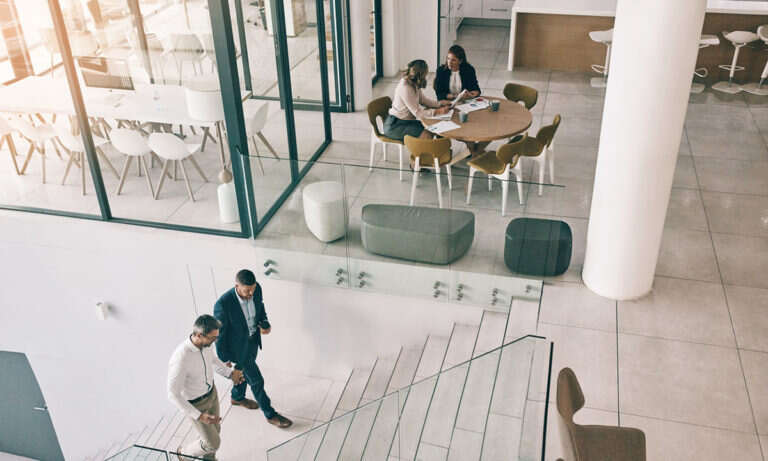 High angle shot of businesspeople in an office as a metaphor for engagement and performance data being used in talent acquisition