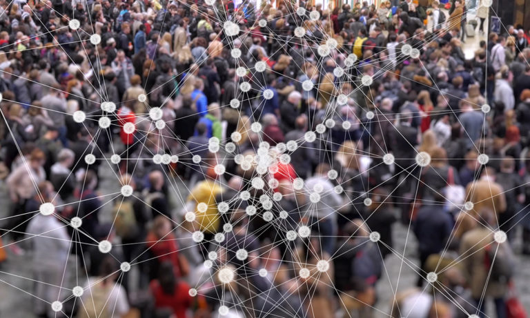 Network analysis graph overlayed on a crowd of people